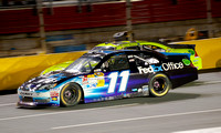 CHARLOTTE, NC - MAY 19: Denny Hamlin 11 passing Paul Menard at t