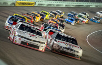 MIAMI, FL - Nov 15: Kyle Larson (42) and Ryan Blaney (12) leadin