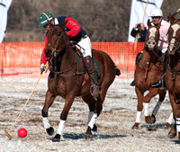 Aspen, CO - Dec 18: A Team US Polo player hitting the ball at the  USPA World Snow Polo Championship in Aspen, CO  on Dec 18, 2011
